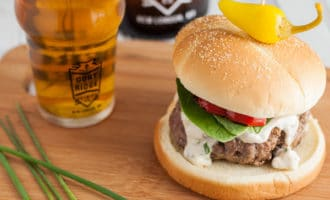 grilled burgers with blue cheese and chive topping