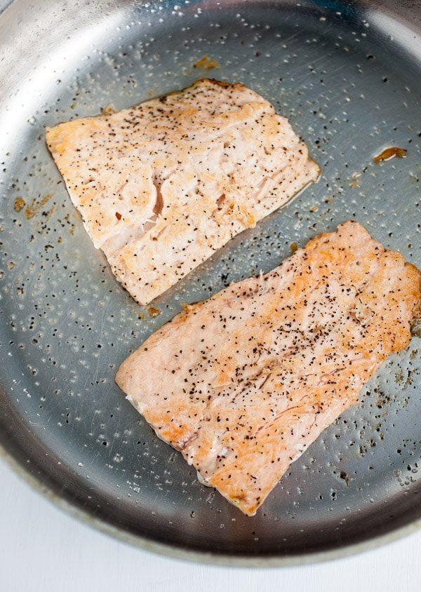 salmon frying in pan