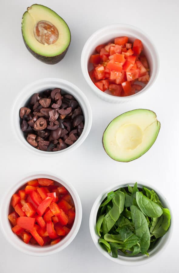 chopped red pepper, spinach, kalamata olives, avocado, and tomato