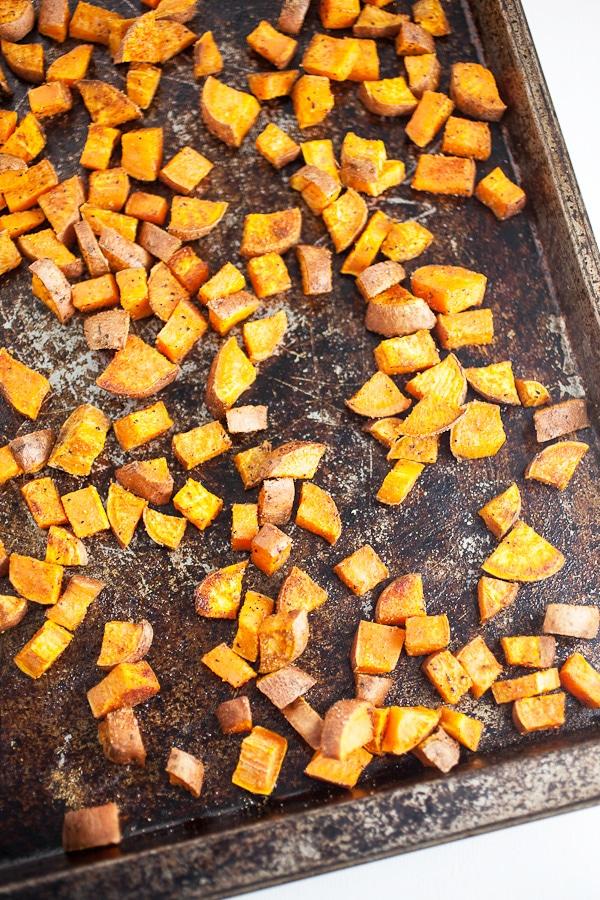roasted sweet potato pieces on pan