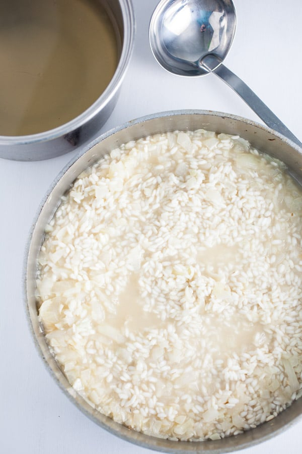 Warm Chicken Broth Added to Risotto in Pan