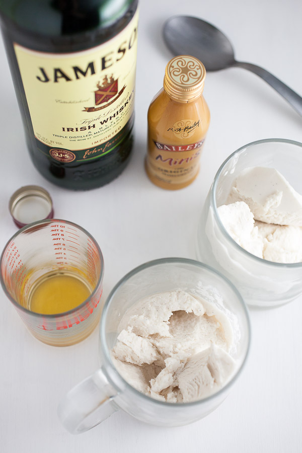 Scoops of coconut ice cream, whiskey, and Bailey's in glasses