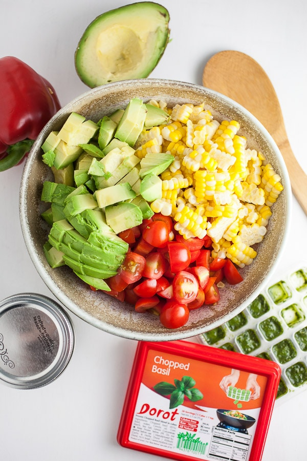 Italian-style salsa ingredients in bowl with Dorot basil