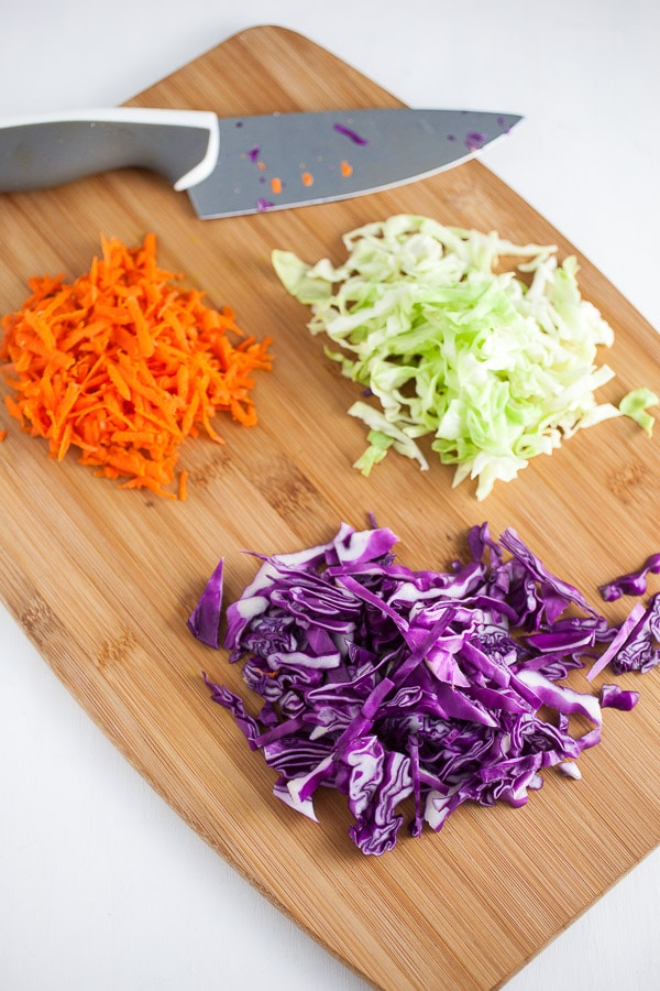 Chopped red cabbage, green cabbage, and carrots