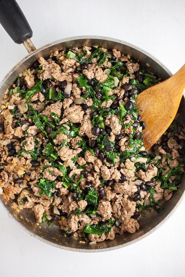 Sauteed ground turkey, black beans, and kale in pan