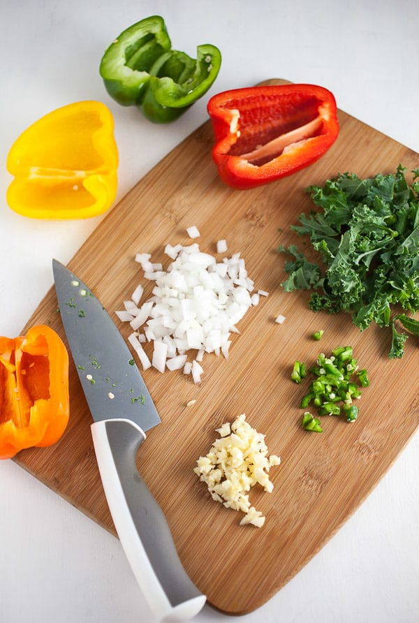 Bell peppers, garlic, onions, jalapenos, and kale