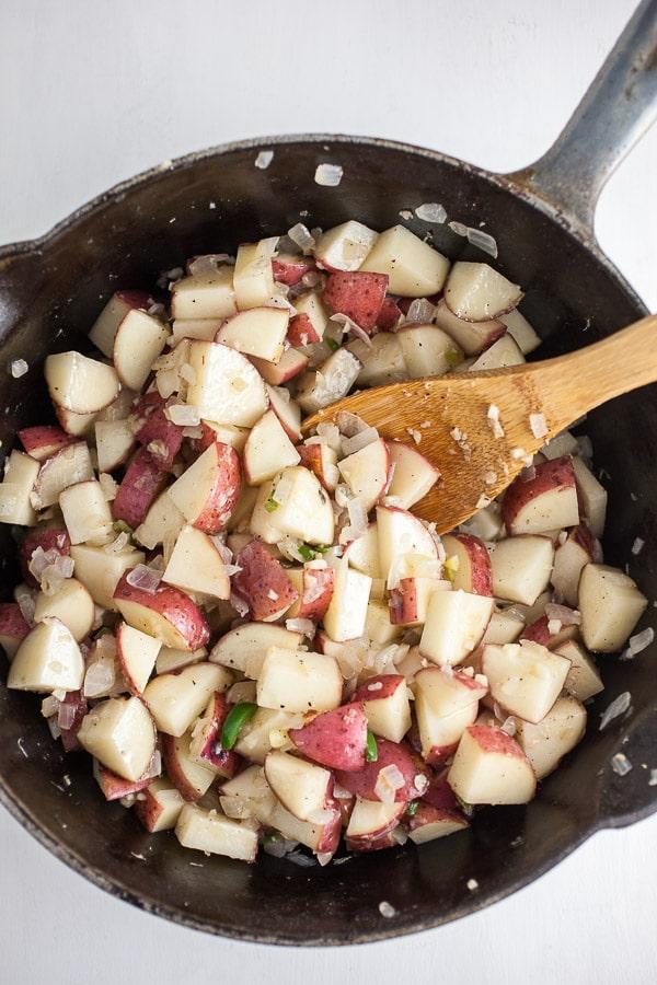 Potatoes, onions, and garlic in pan