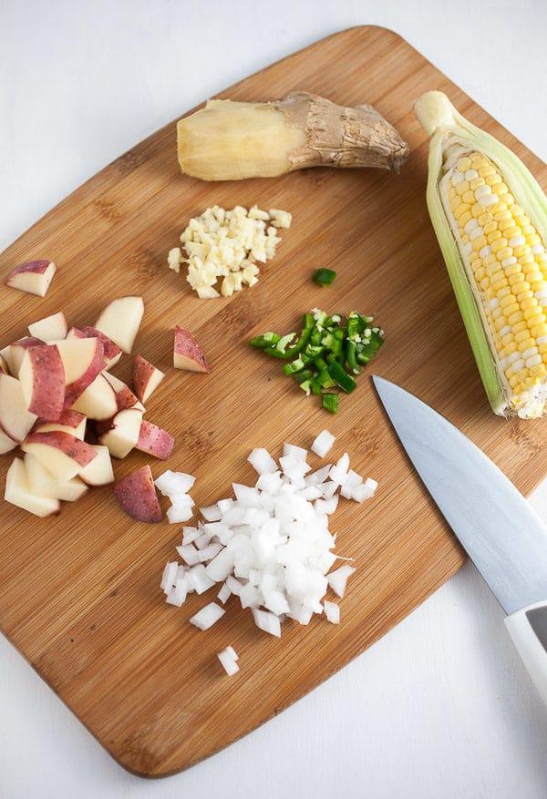 Potatoes, corn, onion, garlic, jalapeno, and ginger